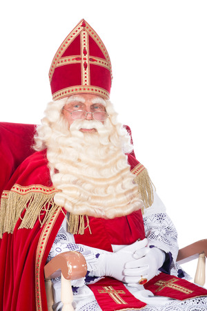 nicolas: Santa Claus is resting on his chair
