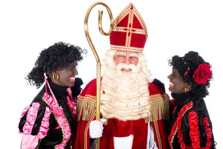 Zwarte Piet is whispering something in the ear of Sinterklaas