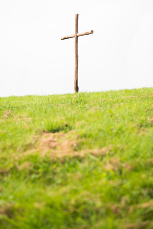 repentance: Wooden cross on a hill, symbol for the crucifixion of Jesus.