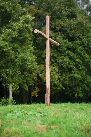 Wooden cross on a hill, symbol for the crucifixion of Jesus.
