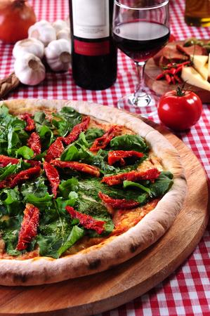 sundried: Pizza of arugula and sundried tomatoes Stock Photo