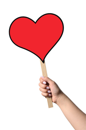 A hand holding a hart shaped speech bubble  Stock Photo