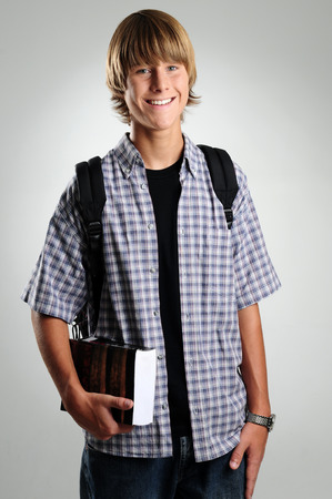 Student with a book and backpack Stock Photo