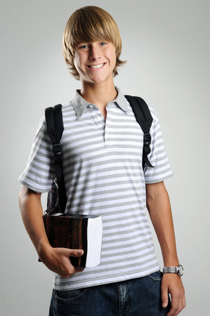 vestibular: Student with a book and backpack Stock Photo