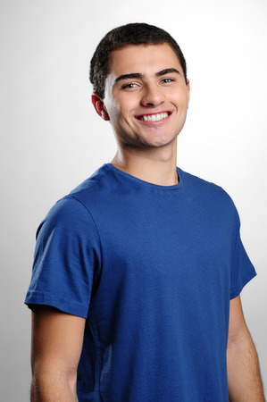 vestibular: Smiling boy smiling wearing blue t-shirt Stock Photo