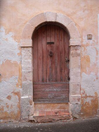 village rustic door wood ocher Luberon Provence France