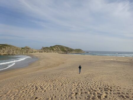 Garden Route Robberg Nature Reserve young man walking in beautiful beach and ocean Plettenberg Bay South Africa. 版權商用圖片