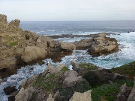 Men Fishing in Garden Route Robberg Nature Reserve 版權商用圖片