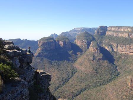 Man with Three Rondawels in Mpumalanga Province, South Africa 版權商用圖片 - 128725535