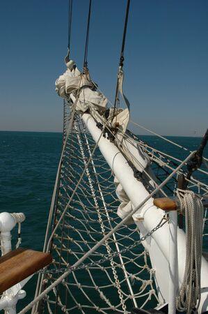 Sailboat bow mast white with rope over chewed 版權商用圖片