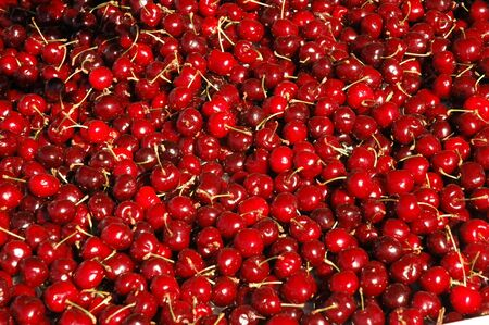 Group of red cherries in the market