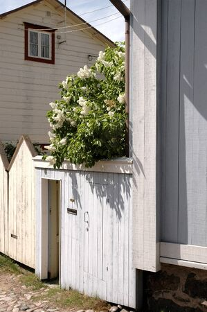 Facade and courtyard of old white house in Porvoo Finland