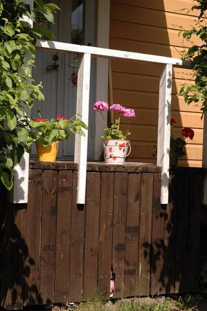 Entrance with container with flowers in a wood house at Porvoo Finland 版權商用圖片