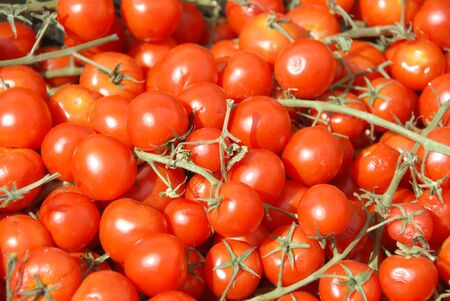 Group of small red cherry tomatoes on the market