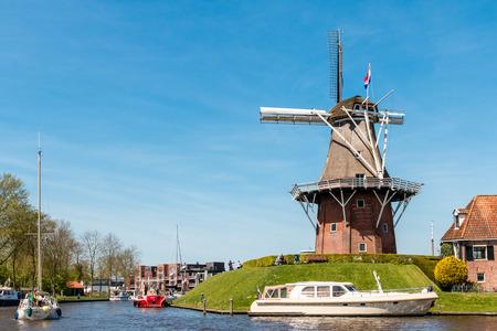 dutch: Dutch windmill against a clear blue sky