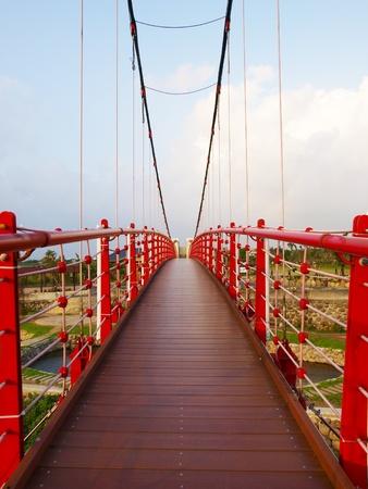 suspension bridge in countryside photo