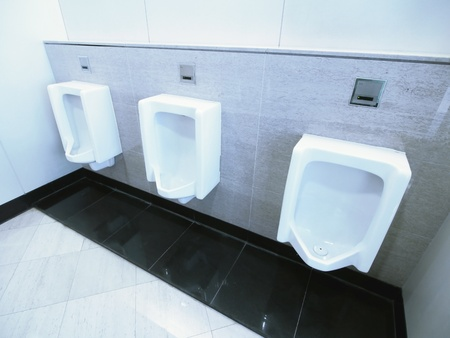 Men lavatory in modern building photo