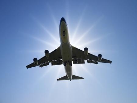 Airplane fly under sunlight photo