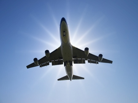 Airplane fly under sunlight