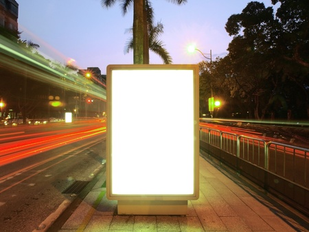 Blank billboard on sidewalk photo