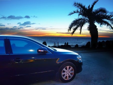 sedan: Car and sunset in seacoast