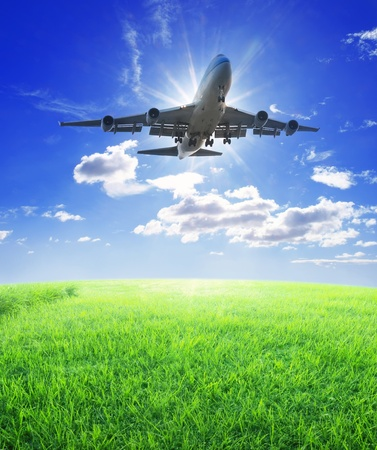 Airplane fly over grass photo