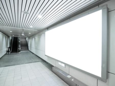 Blank billboard in underground passage
