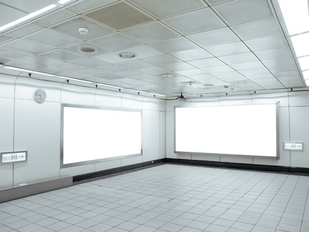 Blank billboard in underground passage photo