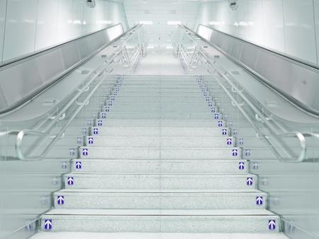 Staircase and escalator in underground passage photo