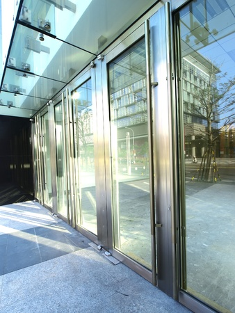 glass doors: Transparent door of modern building Stock Photo