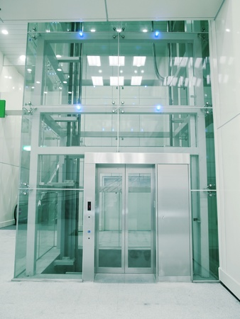 metal handrail: Transparent elevator in underground passage