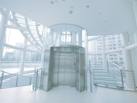 elevator: Transparent elevator and staircase  Stock Photo