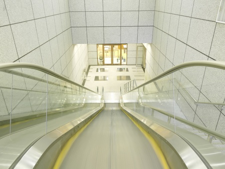 moving down: Escalator to underground Stock Photo
