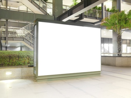 Blank billboard in modern building photo