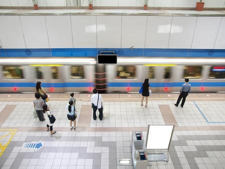Train passing subway station photo