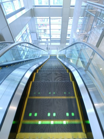 metal handrail: Escalator in department store  Stock Photo
