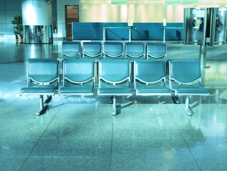 airport check in counter: Chairs in the airport Editorial
