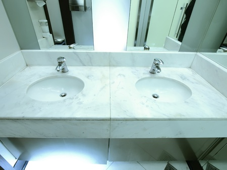 Faucet and washbasin in lavatory photo