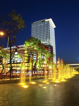 led lamp: Modern building and  fountain in night