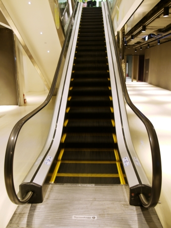 Escalator in department store photo