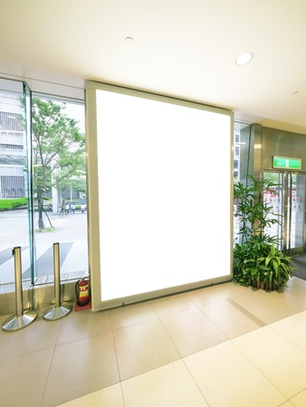Blank billboard and glass wall photo