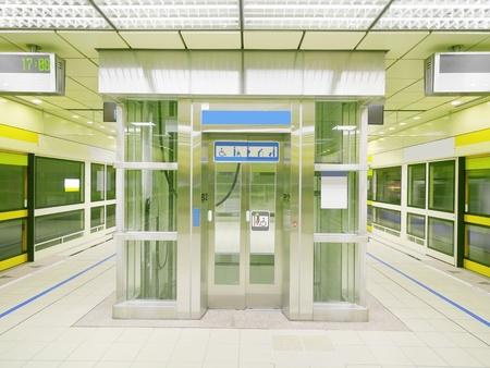 subway platform: Transparent elevator in subway platform Stock Photo