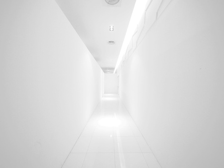 Blank wall and long walkway photo