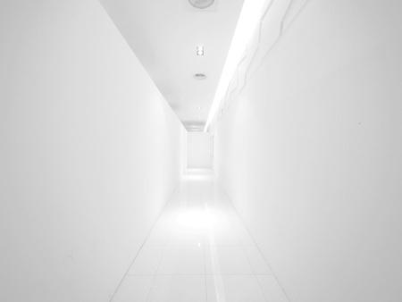 Blank wall and long walkway photo