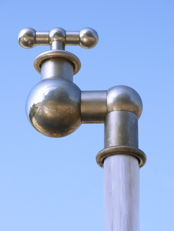 spout: huge faucet and water