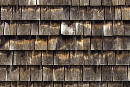 Cedar shingles for siding and roof photo