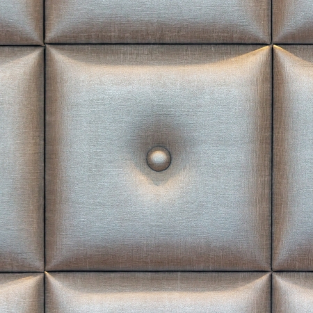 buttoned: Silver fabric buttoned  background pattern Stock Photo