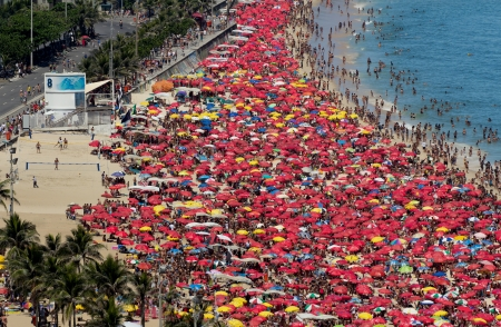People relaxing during carnival on Ipanema Beach