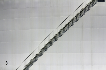 Outside empty metal stairs on the white metal pattern Stock Photo - 14749146