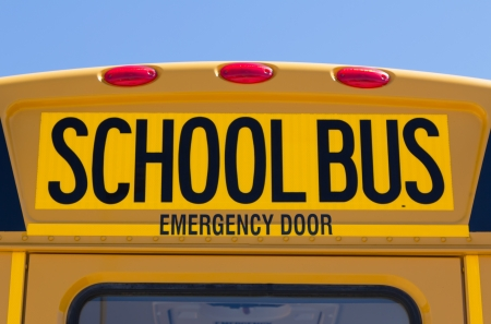 Back of school bus with a sign photo